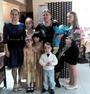 С внучкой и ее сестрами, и братьями.
